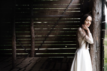 bride in an abandoned wooden stock