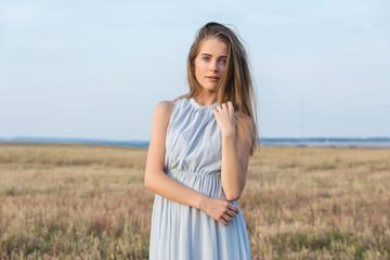Beauty Romantic Girl Outdoors. Beautiful Teenage Model girl Dres