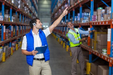 Warehouse workers interacting with each other