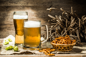 Mug, glass of beer on wooden table
