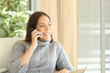 Woman talking on a land line phone