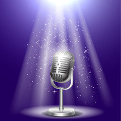 the realistic vintage microphone on stage with light rays.