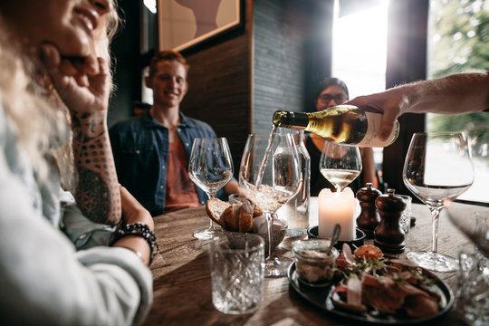Friends having drinks at restaurant