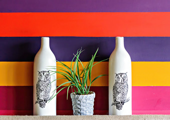 Cafe installation of two white porcelain bottles with painted owls