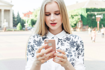 Girl texting on the smart phone