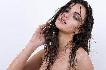 Sexy  woman with wet hair beauty on white