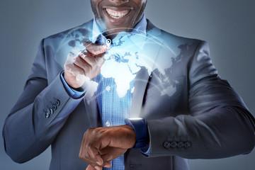 Global business travel hologram from smartwatch on black busines