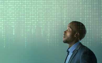 Black man with glowing green binary code background