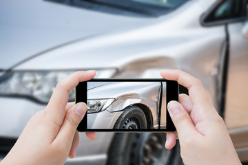 woman using mobile smartphone take photo car crash accident