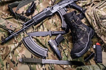 Army boot and different weapon/Military boot, gun, knife, rifle, pistol and machete.Top view