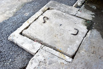 Drain cap made of cement that are eroding.
