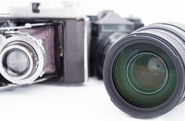 Group of Old retro vintage cameras. Antique lens equipment. Classic creative background