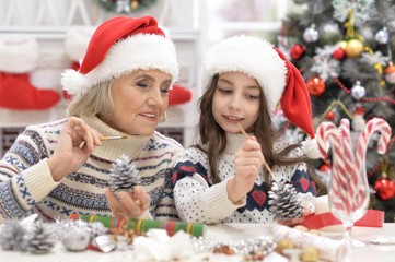 Grandmother with child preparing for Christmas