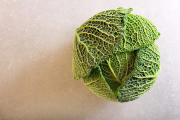 Savoy cabbage over grey background