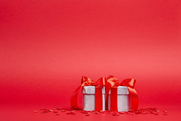 Red background with silver gifts and confetti