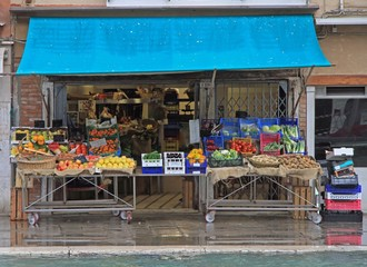 stand with fruits and vegetables outdoor in Venice, Italy
