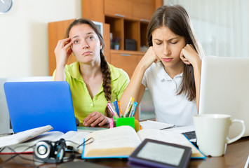 Teenage student girls study at home