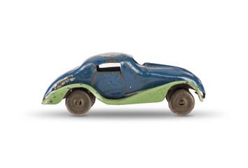 Vintage tin toy car on white background