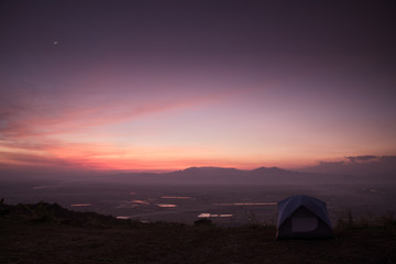 mountain dawn with tent, pink and violet colors of sky and cloud