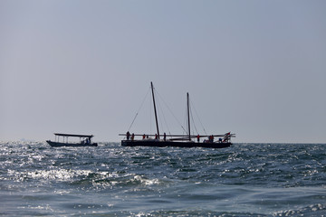 Silhouette of racing traditional dhow in the Arabian Gulf, off Abu Dhabi