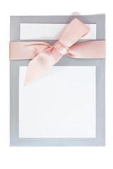 Notecard with gray / grey border and pink ribbon bow. Copy space. Vertical.