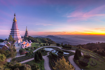 two famous pagoda at colorful pink sunset. Doi Inthanon national park, Thailand