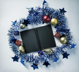 Vintage Christmas background photo. Black spiral notebook open.