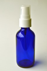 Dark blue glass pump bottle for cosmetic lotions, serums, oils and liquids