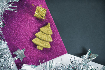 Vintage Christmas background. Toned photo of fir tree ornament on glitter pape