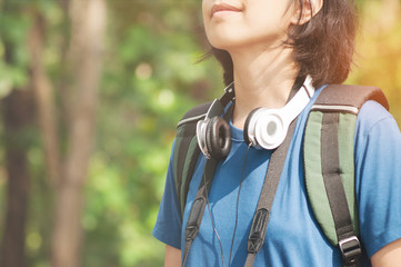 Beautiful girl with wear headphone smiling on nature background.