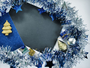 Christmas or New Year composition on white. Blue sparkling ribbon wreath.