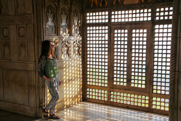 Young woman standing by the window in Khas Mahal, Agra Fort, Utt