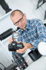 technician examining and repairing dslr camera