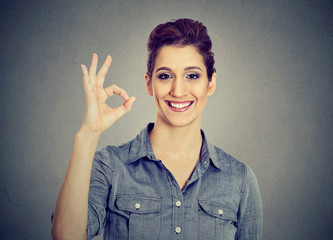 Young woman gesturing OK sign