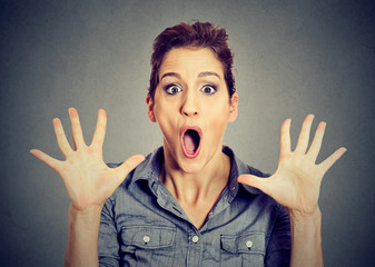 excited surprised young woman screaming