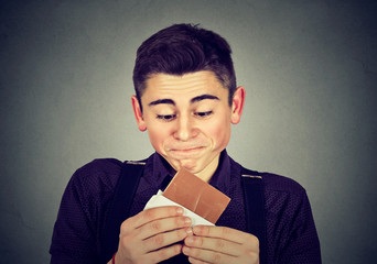 Man tired of diet restrictions craving sweets chocolate.
