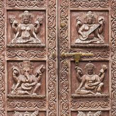 Detail wooden carved door in hindu temple, Kathmandu, Nepal background. Close up