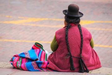 Local woman sitting at Plaza de Armas in Cusco, Peru