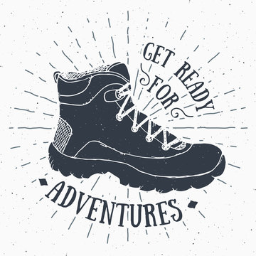 Vintage label, grunge textured Hand drawn retro badge or T-shirt typography design with hiking shoe, trekking boot vector illustration.