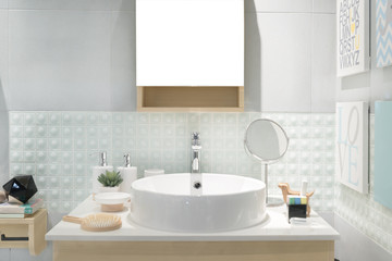 Interior of bathroom with sink basin faucet and mirror. Modern d