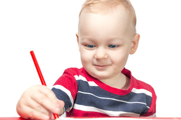 little boy with pencil on a white backgraund