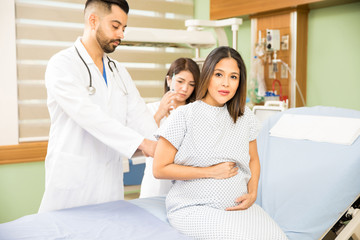 Worried pregnant woman in a hospital
