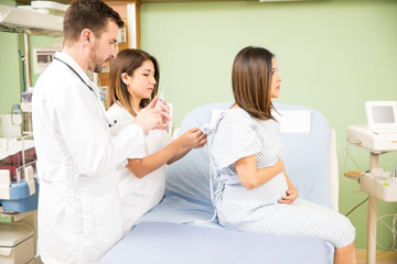 Pregnant woman receiving medical attention