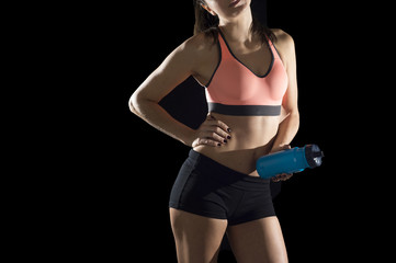 cropped face body detail portrait of young athletic female body of sport woman bottle water