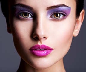 Foto auf Acrylglas Beauty Beautiful girl's face closeup with purple eye make-up. fashion m