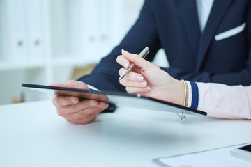 Business presentation on tablet computer.