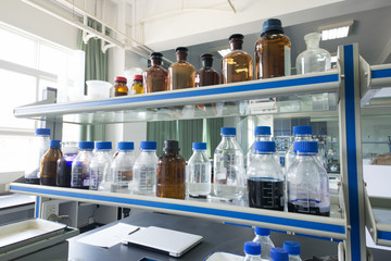 Chemical Bottles in Laboratory Shelf