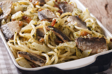 Italian pasta bucatini with sardines, fennel, raisins and pine nuts close up. horizontal