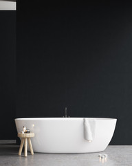Bathtub with a chair and a black wall