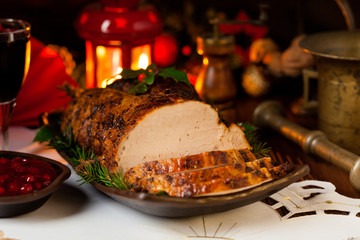 Roast pork loin with Christmas decoration.
